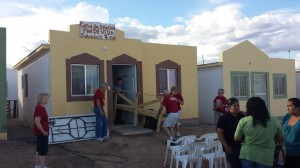 the people of Juarez make the journey to a small stucco house for worship
